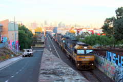 Freight train crossing Maribyrnong River and soon entering Bunbury Street Railway Tunnel