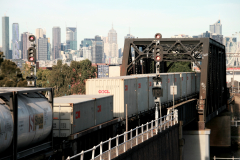 Freight train crossing Maribyrnong River and entering Bunbury Street Railway Tunnel