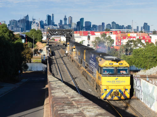 1 Indian Pacific and 2 Pacific National locos cross the bridge over Maribyrnong river before entering the Bunbury Street Tunnel (19.5.2019)